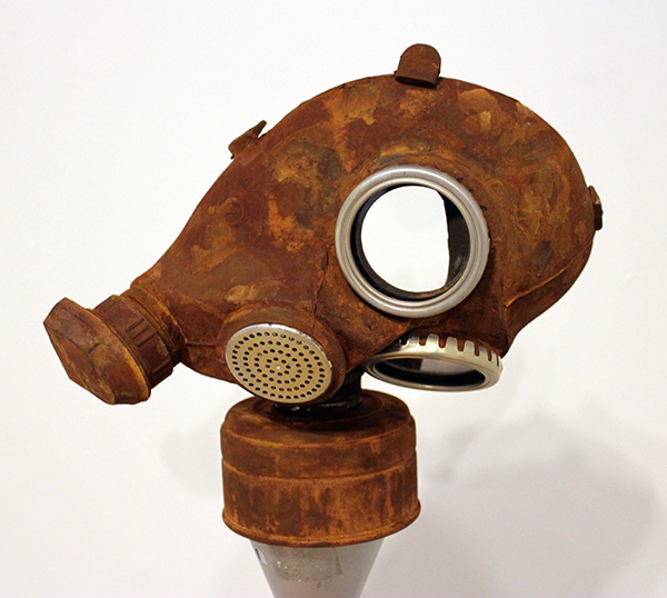 Rusted Mask (front view, on pedestal)